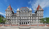The facade of the New York State Capitol building in bright daylight