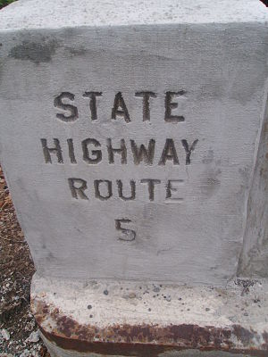 A stamp on a bridge reading State Highway Route 5