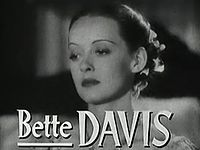 "close up photo of classic film actress with ""Bette Davis' written across the bottom of the image"