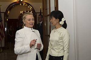 Clinton standing with Aung San Suu Kyi. The two women are discussing something during Clinton's 2011 visit to Burma.
