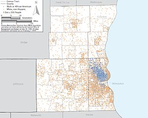 Map showing a large concentration of black residents in the north side of metropolitan Milwaukee.