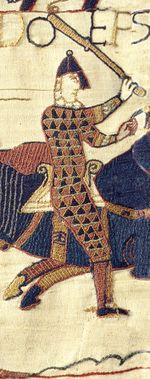 Embroidered image of a walking man in chainmail and helm holding a club over his head