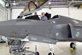 Defense Secretary Chuck Hagel sits in an F-35A Lightning II joint strike fighter aircraft on Eglin Air Force Base, Fla., July 10, 2014, during a two-day trip to visit bases in the South 140710-D-xxxxM-003c.jpg