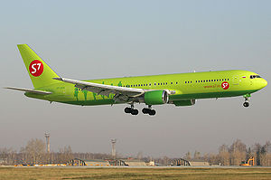 A S7 Airlines Boeing aircraft with wheels down on final approach to land