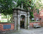Forecourt wall and gateway of Wright's Almshouses, Beam Street