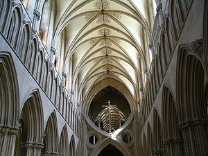 an interior view of the nave at Wells as described in the text. The nave terminates abruptly in a structure known as St Andrew's Cross, which was inserted to support the tower.