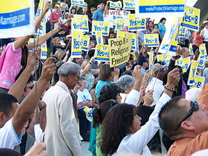 photograph of a throng of people holding signs