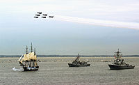 Photo of Constitution under sail with two escorts as navy jets fly overhead