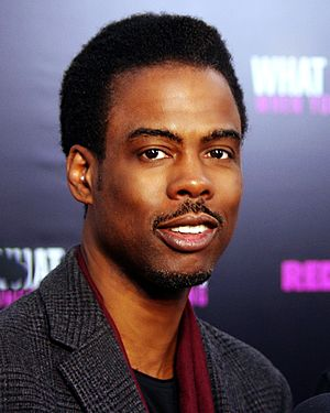 A photo of Chris Rock attending the premiere of the 2012 film What to Expect When Your Expecting.