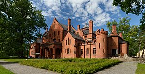red stone manor house in neo-gothic style
