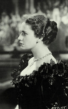 young woman, dark-haired, in left profile