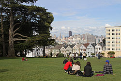 "Looking across Alamo Square Park towards the famous ""Painted Ladies"" and city skyline"