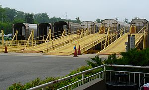 Autoracks lined up at their loading ramps at the Lorton station.