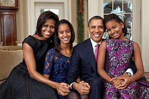 The Obamas embracing and smiling
