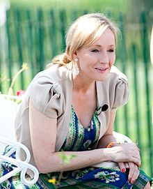 J.K. Rowling, a blond, blue-eyed woman, who is the author of the series