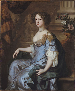 Portrait of Mary with brown hair and in a blue-and-gray dress
