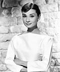 Black-and-white photo of Audrey Hepburn from 1956.