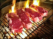 Beef steaks being grilled