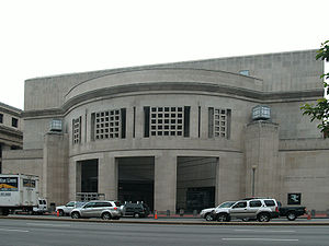 14th Street Entrance of USHMM. Large, rectangular façade with rounded opening.