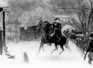 Black and white print shows George Washington on horseback leading his soldiers and pointing with his sword. The combat is taking place on a town street with Hessian soldiers visible in the background.