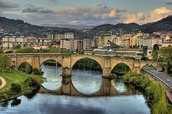 View of the Roman bridge Ponte Vella, in Ourense that traverses the Miño river