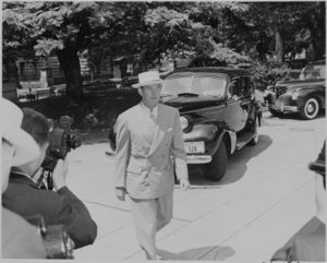 Photograph of Postmaster General Robert Hannegan, evidently arriving at the White House for a Cabinet meeting. - NARA - 199143.jpg