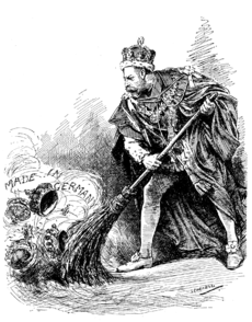 "George V dressed in the ceremonial robes of the Order of the Garter uses a broom to sweep aside assorted crowns labelled ""Made in Germany"""