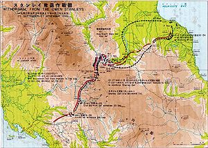 A map with Japanese and English characters on it, depicting the withdrawal of Japanese forces north over the Owen Stanley Range along the Kokoda Track. The route of the Japanese withdrawal is shown in black dotted arrows, while the advance of the Australian forces that followed them up is shown in red