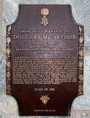 "A bronze plaque with an image of the Medal of Honor, inscribed with MacArthur's Medal of Honor citation. It reads: ""For conspicuous leadership in preparing the Philippine Islands to resist conquest, for gallantry and intrepidity above and beyond the call of duty in action against invading Japanese forces, and for the heroic conduct of defensive and offensive operations on the Bataan Peninsula. He mobilized, trained, and led an army which has received world acclaim for its gallant defense against a tremendous superiority of enemy forces in men and arms. His utter disregard of personal danger under heavy fire and aerial bombardment, his calm judgment in each crisis, inspired his troops, galvanized the spirit of resistance of the Filipino people, and confirmed the faith of the American people in their Armed Forces."""