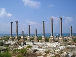 Ruins of columns near the sea.