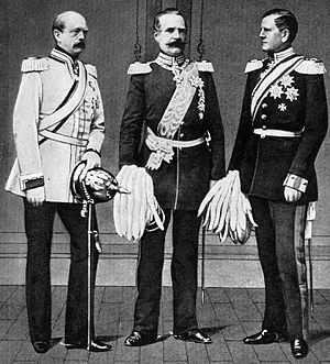 three men in military uniforms carrying pickel helmets—the ones with pikes sticking out of the crowns