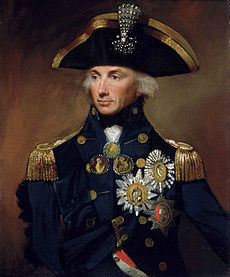 Portrait of a man in an ornate naval uniform festooned with medals and awards.