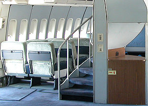 A helical staircase on 747-100s and -200s that leads to the upper deck