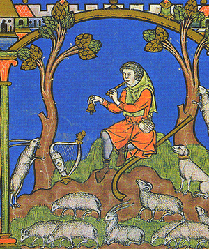 A painting showing a man in orange clothes playing a pipe and ringing a small bell. He is surrounded by numerous small white sheep, and two trees sit on either side of him. A small village is depicted in the upper left hand corner.