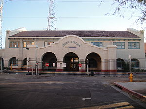 front view of the southwestern architecture of the closed Union railroad station in Phoenix, surrounded by a chain link fence