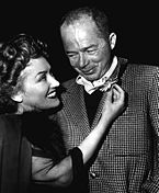 Black-and-white photograph of Gloria Swanson and Billy Wilder while filming Sunset Boulevard.