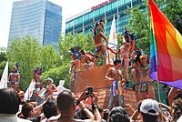 Gay-rights parade float with Aztec eagle-warrior theme