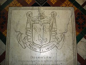 "A white carved stone slab. At the top, a coat of arms with a shield of three cockerels, topped by a knight's helmet; underneath, the motto ""Vigilijs et virtute"". The text of the memorial reads ""Depositum / illustrissimi viri D. Leolini Ienkins / LL. Doctoris et equitis aurati"""