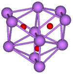 The stick and ball diagram shows three regular octahedra, which are connected to the next one by one surface and the last one shares one surface with the first. All three have one edge in common. All eleven vertices are purple spheres representing caesium, and at the center of each octahedron is a small red sphere representing oxygen.