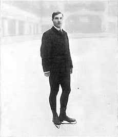 a man standing on ice in figure skates