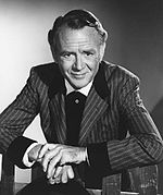 Black and white photo of John Mills in 1965.