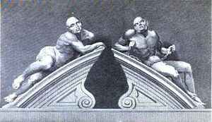 Two male figures reclining on the stone gate pillars of the Bethlem entrance, carved in Portland stone. Both figures are semi-naked. The figure on the left represents melancholic madness and looks languid and lethargic. The figure on the right, representing frenzied madness is restrained by chains and its body looks taut and muscular.