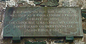 Plaque on Keswick's Moot Hall, giving construction and rebuilding dates of 1571, 1695 and 1813