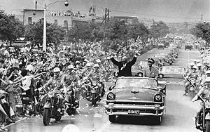 While visiting Taipei, Taiwan in June 1960, U.S. President Dwight D. Eisenhower waves to crowds Taiwanese people from an open car next to Chiang Kai-shek.
