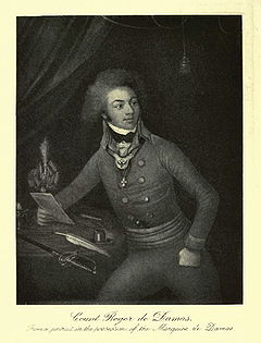 Black and white print of a man sitting at a desk holding a letter. He wears a military coat with two rows of buttons and a gorget at his collar. He has a thick shock of curly hair about his head and well-defined eyebrows over alert eyes.