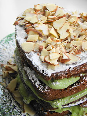 A mocha almond fudge avocado layer cake. Avocado is present within the layers of the cake.