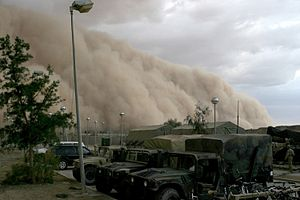 dark brown sand storm about to engulf a motor pool