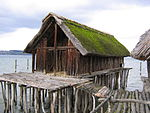 Reconstruction of a pile house at the Pfahlbau Museum Unteruhldingen on Lake Constance in Germany