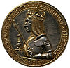A gold-and-silver coin featuring the bust of a crowned man in armour, holding a sceptre and a sword. The bust is surrounded with the text 'Maximilianus Dei Gra Rex & Imper Augustus'.