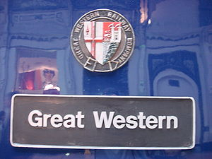 "A black nameplate stating ""Great Western"" with a multi-coloured shield above."